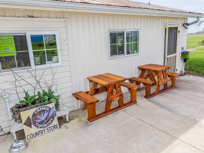 Store with Redwood Tables Outdoors
