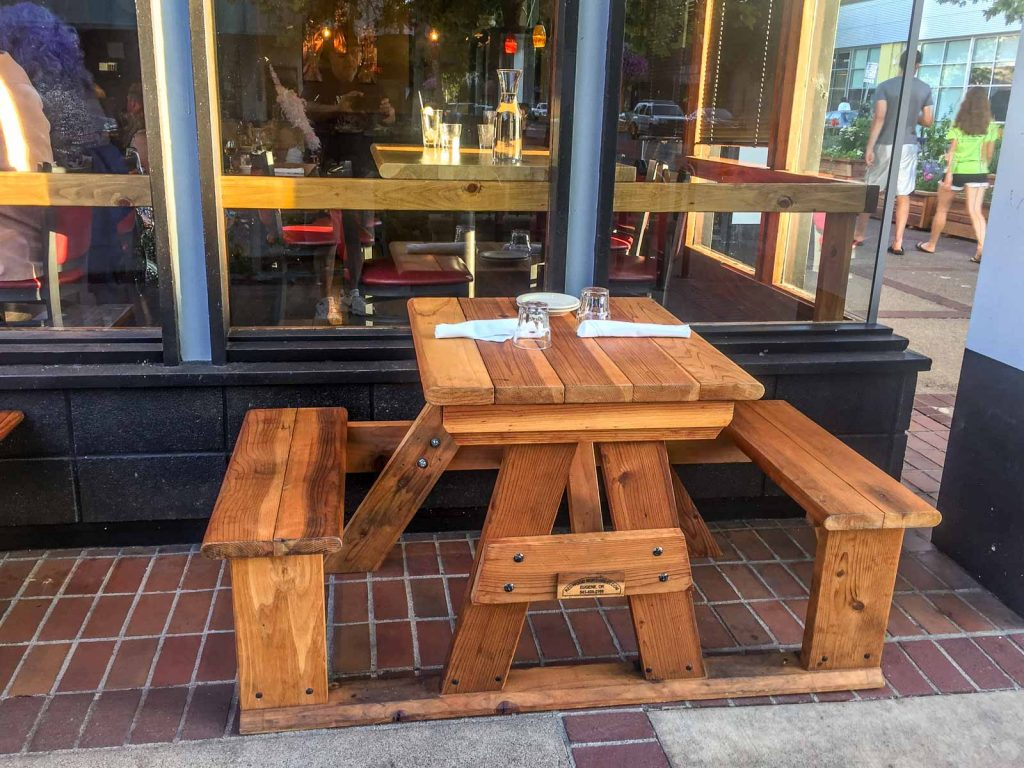 Step side redwood table used outside restaurant